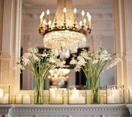 elegant-wedding-reception-venue-ivory-wedding-flowers-candles.original